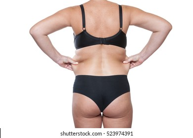 Closeup Wrinkles  Body  Woman, Wrinkles at the Waist. Fat Woman in Underwear Back. Female Waist. Body Women After Childbirth, Excess Fat Woman. Wrinkles on his  Stomach. Isolated on white Background