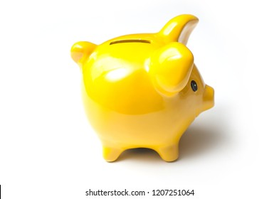 closeup of yellow piggy bank on white background