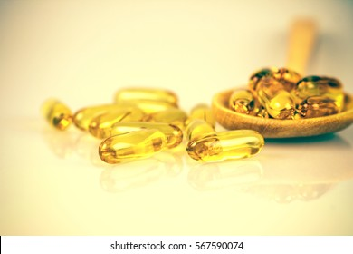 Closeup the yellow soft gelatin supplement fish oil capsule