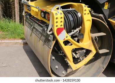 Closeup of a yellow steamroller