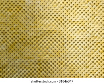 Close-up of yellow stone wall with triangle shadow