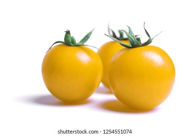 Close-up of yellow Tomatoes isolated on white Background.