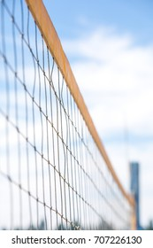Close-up of the yellow volleyball net
