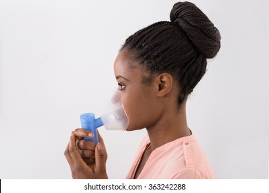 Close-up Of Young African Woman Using Oxygen Mask