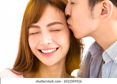 closeup young asian couple kissing