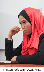 Closeup of a young asian muslim women thinking
