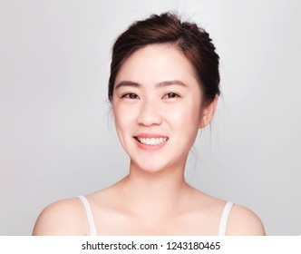 closeup young attractive beautiful asian woman smiling face with clean skin, Cosmetic Beauty Concept, skin care image on gray background