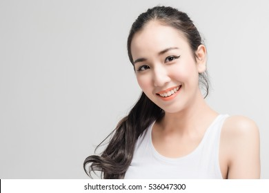 Closeup young beautiful woman face smile pure cosmetic skin
