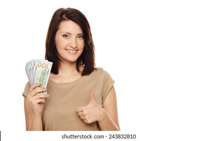 Closeup of young beautiful woman with us dollar money in hand, gesturing thumb up, over white background, with copy spac
