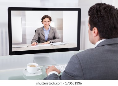 Close-up Of A Young Businessman Chatting With Her Colleague