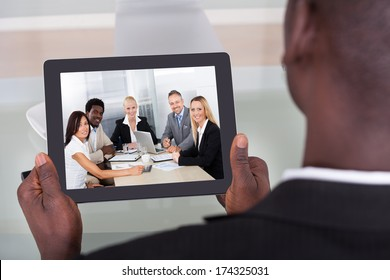 Close-up Of A Young Businessman Chatting With His Colleague
