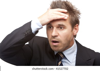 Closeup of a young businessman which is shocked. Isolated on white.