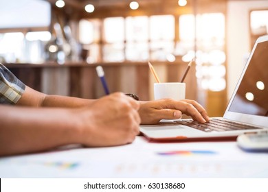 Closeup young businessman'hand typing laptop for search information his work