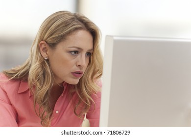 Close-up of young businesswoman looking at computer
