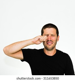close-up of young caucasian man crying - isolated on white background with copyspace