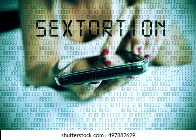 closeup of a young caucasian woman face down in bed using a smartphone and the word sextortion in the foreground