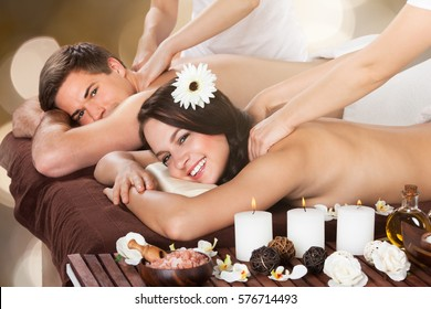 Close-up Of A Young Couple Receiving Shoulder Massage At Beauty Spa