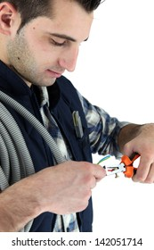 closeup of young electrician at work