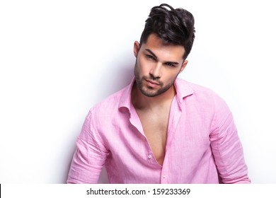 closeup of a young fashion man looking at the camera with a serious look on his face. isolated on a white background