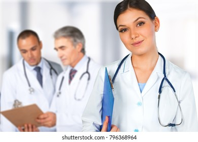 Close-up of a young female caring doctor