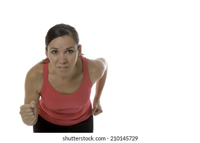 closeup of a young female runner ready to run looking at the front isolated on a white background