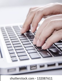 Closeup of young female typing on keyboard