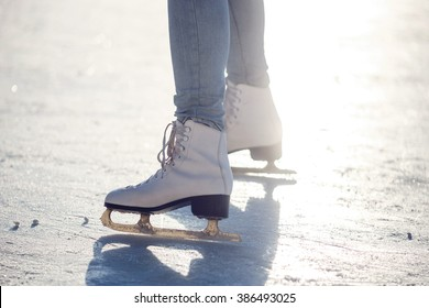 Closeup of young girl on the  figure skates outdoor in sunny spring day