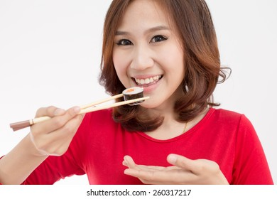 Close-up. young lady eating sushi roll