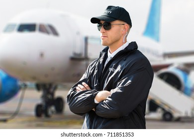 Close-up Of A Young Male Security Guard With Arms Crossed