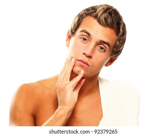Closeup of a young man after shaving , isolated on white background