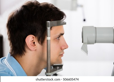 Close-up Of A Young Man Checking Eyesight In Clinic