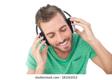 Close-up of a young man enjoying music over white background