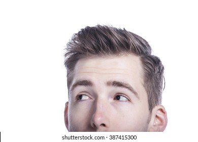 Close-up of young man looking away on white background.
