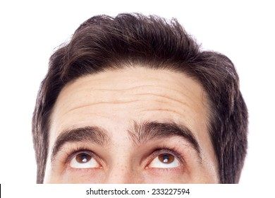 Closeup of a young man looking up, isolated on white background