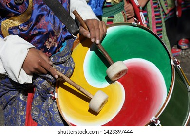 Close-up of a young man playing drums at the inaugural procession of the Ladakh Festival in Leh, Ladakh, India.