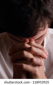 Close-up of young man praying