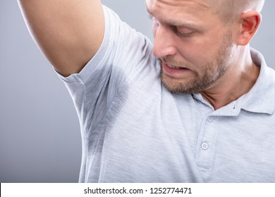 Close-up Of A Young Man Sweating Badly Under Armpit