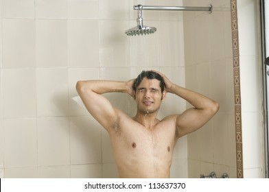 Close-up of a young man taking a shower