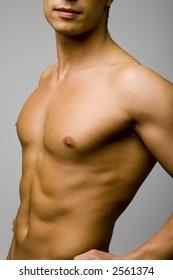 Closeup of young and muscular man's torso.