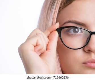 Closeup of young pretty woman wearing eyeglasses looking away