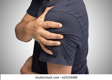Closeup of young shirtless man with shoulder pain, Upper arm pain, People with body-muscles problem, Healthcare And Medicine concept