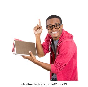 Closeup of a young smart handsome man, wearing big glasses, holding books, prepared and ready to ace his exam test finals, isolated on white background. Positive facial expressions, feelings, emotions