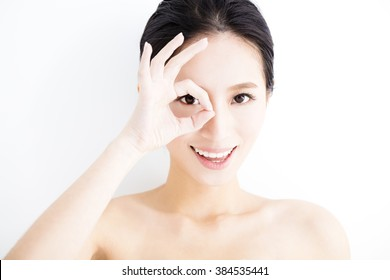 Closeup of young smiling woman eyes with gesture