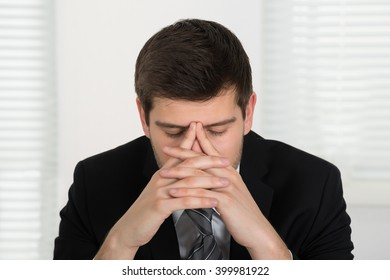 Close-up Of Young Unhappy Businessman In Office