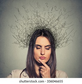 Closeup young upset woman with worried stressed face expression eyes closed and brain melting into lines question marks deep thinking. Obsessive compulsive, adhd, anxiety disorders