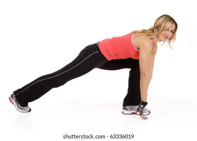 Close-up of a young woman exercising against white background