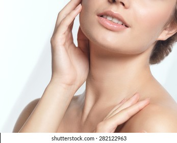 Closeup of young woman face beauty portrait with natural look