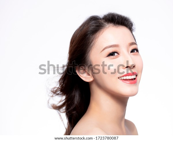 closeup young Woman face with hair motion on white background