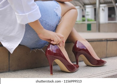close-up young woman feeling pain in her foot on stair, Have ankle pain, Health concept