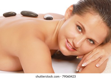 Closeup of a young woman getting spa treatment, focus on her back